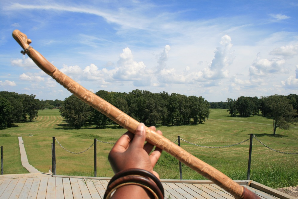 An Ornately Carved Atlatl & Obscure Cloud Formations
