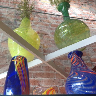 A colorful collection of vases for sale at Central Glass Works.