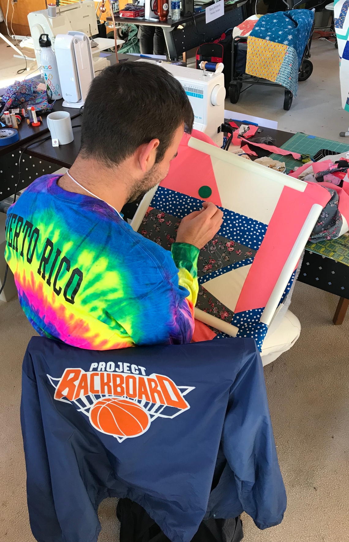Sam hand stitching his 1st quilt. - Sophisticated SolWorks©